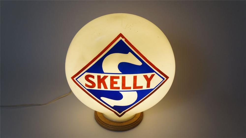 1927 Skelly Gasoline one-piece milk glass gas pump globe with baked on painted logo. - Front 3/4 - 177968