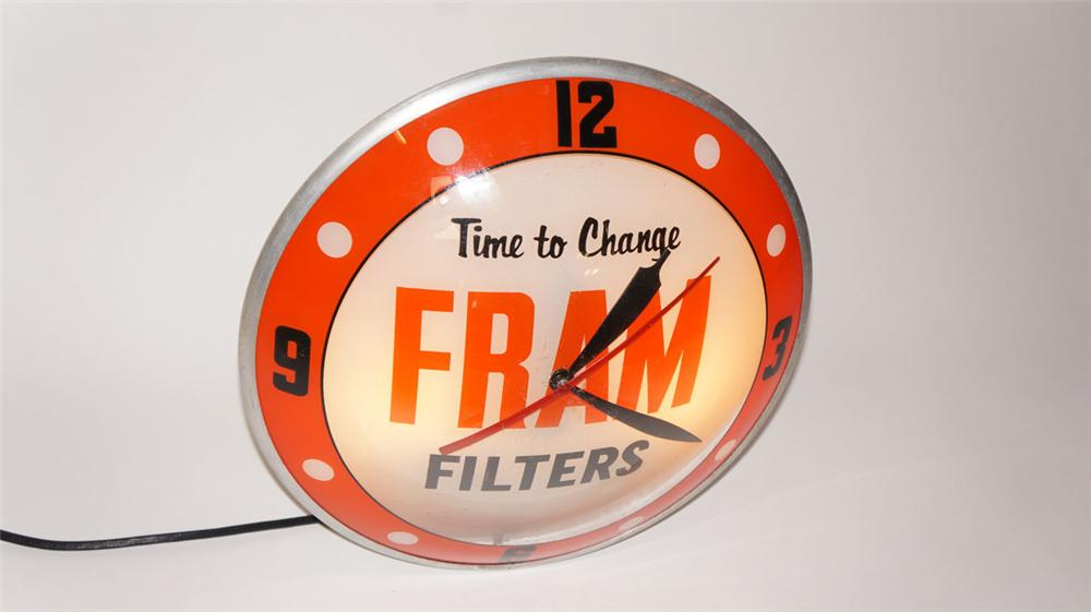 Highly desirable 1950's Fram Filters double-bubble glass faced automotive garage clock. - Front 3/4 - 177973