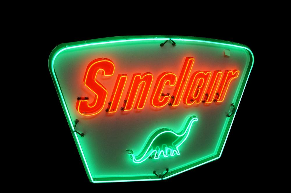 Stunning late 1950's Sinclair Oil single-sided porcelain with animated neon service station sign featuring the dino logo. - Front 3/4 - 178020