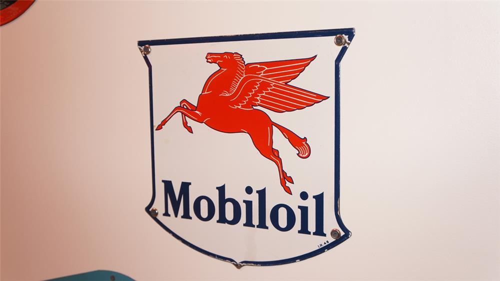 Choice 1946 Mobil Oil single-sided die-cut porcelain shield shaped pump plate sign with Pegasus logo. - Front 3/4 - 178757
