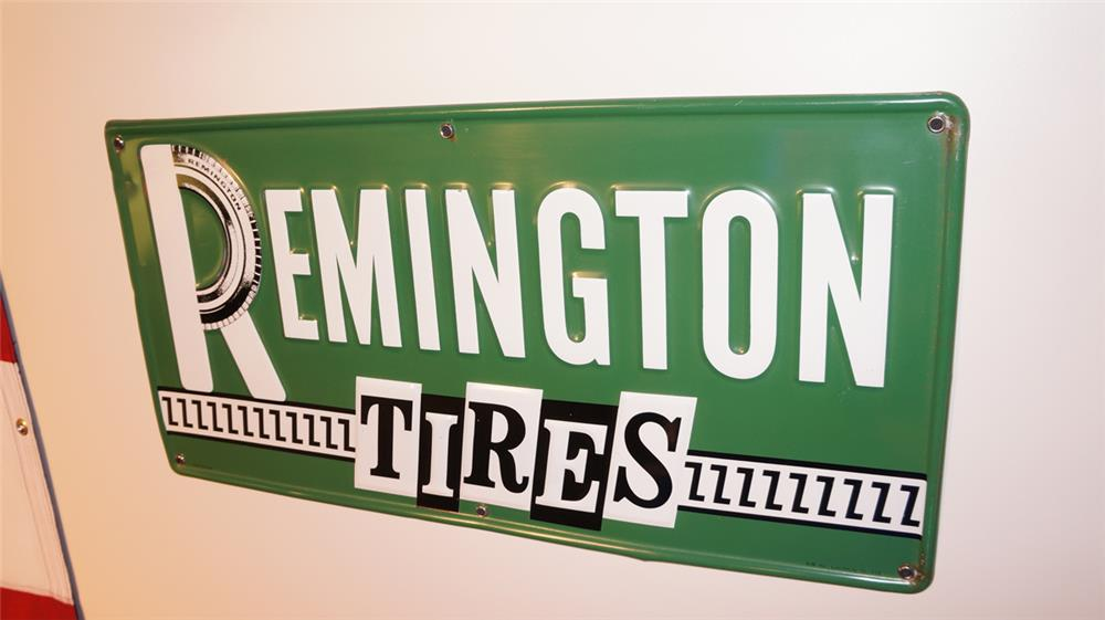 Very nice late 1950's Remington Tires single-sided embossed tin automotive garage sign. - Front 3/4 - 178762