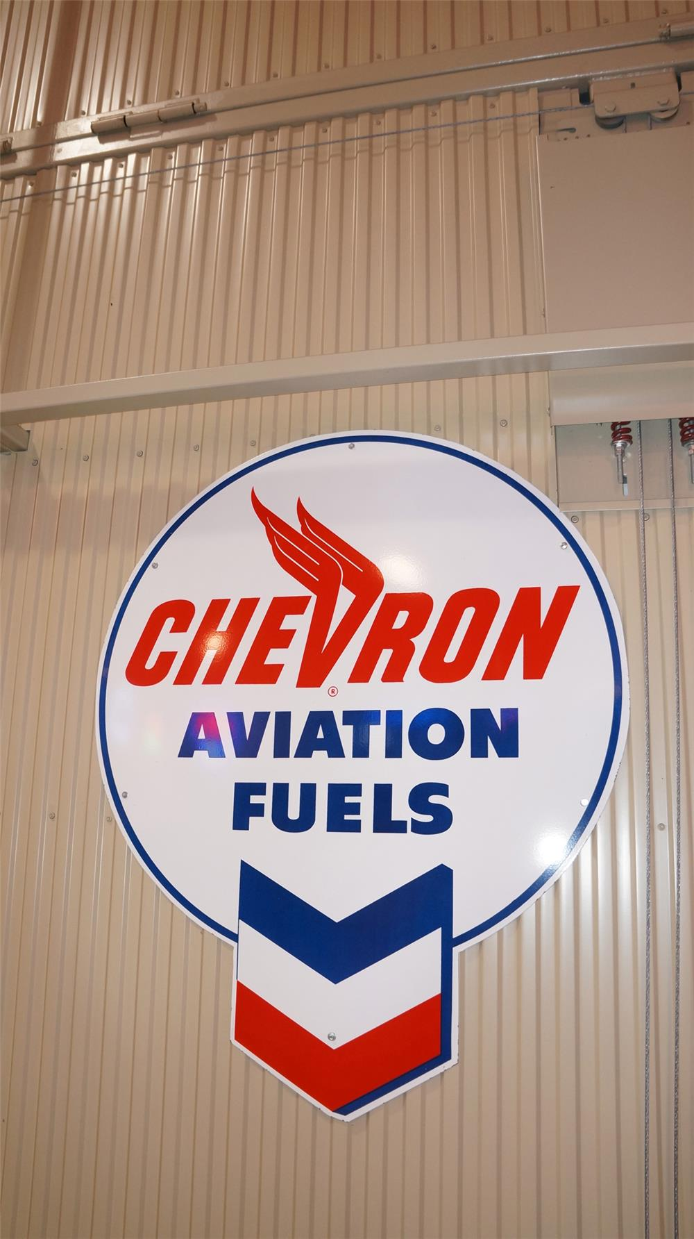 Killer large N.O.S. 1950's Chevron Aviation Fuels single-sided porcelain airport maintenance hanger sign. - Front 3/4 - 178778