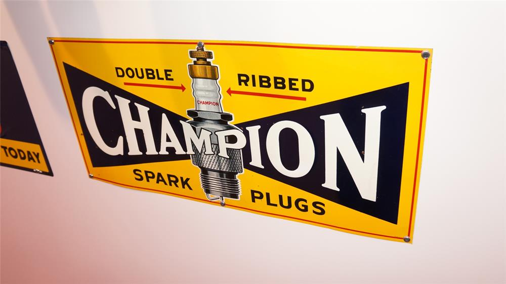 N.O.S. 1930's-40's Champion Spark Plugs single-sided embossed tin automotive garage sign with spark plug graphic. - Front 3/4 - 178783