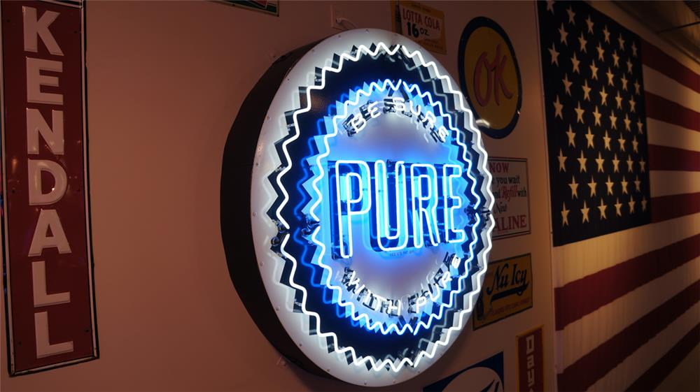 "Awesome 1950's Pure Oil ""Be Sure with Pure"" single-sided porcelain with neon service station sign. - Front 3/4 - 178800"