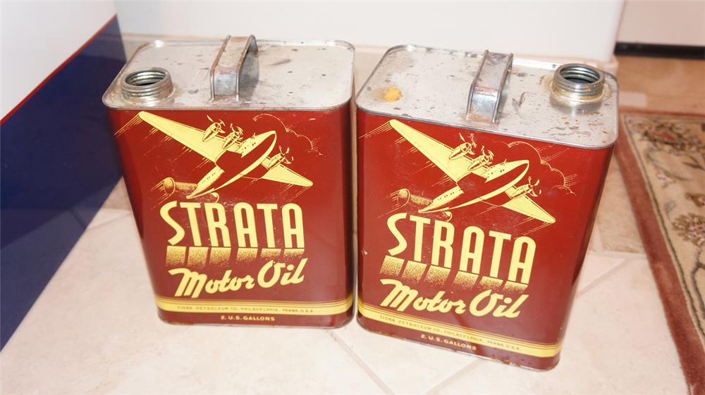 Lot of two 1940's Strata Motor Oil one gallon tins with airplane graphics. - Front 3/4 - 178806