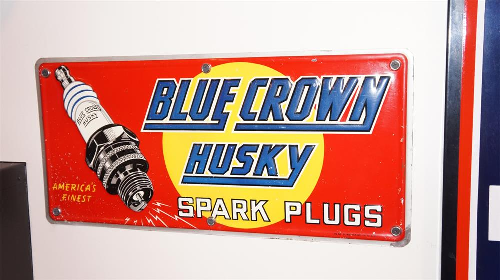Good Looking 1940's Blue Crown Husky Spark Plugs single-sided embossed tin sign with spark plug graphic. - Front 3/4 - 178815