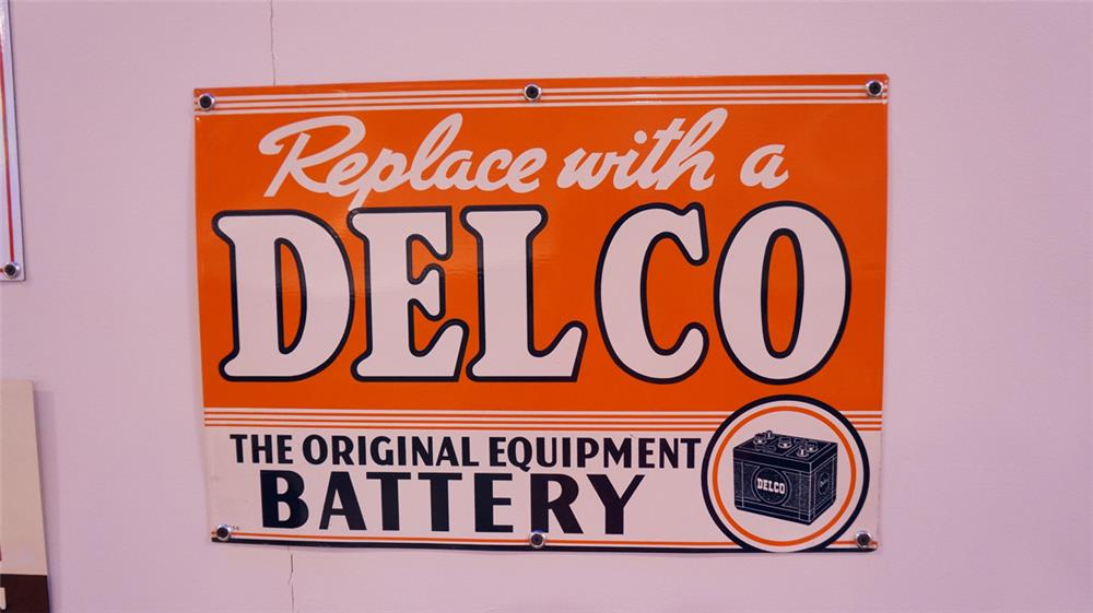 N.O.S. 1950 Delco Battery single-sided tin automotive garage sign with battery graphic. - Front 3/4 - 178832