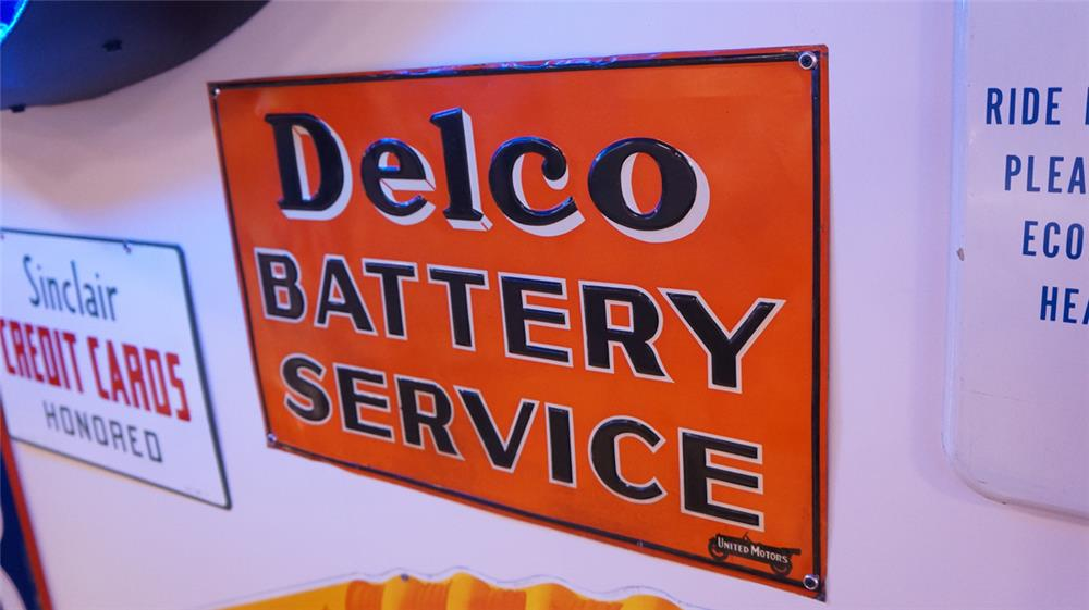 N.O.S. 1920's-30's Delco Battery Service tin sign with nice touring car logo. - Front 3/4 - 178839