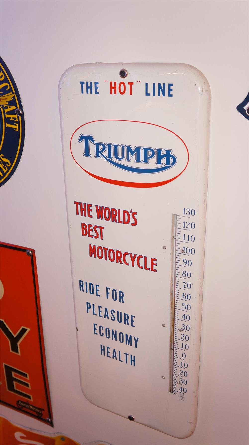 1950s Triumph Motorcycles single-sided tin dealership thermometer. - Front 3/4 - 178840