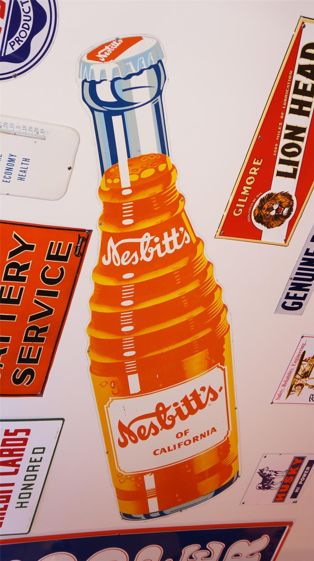 Large 1950's Nesbitt's Orange Soda die-cut tin bottle sign. - Front 3/4 - 178850