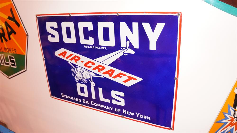Striking 1930's Socony Aircraft Oils single-sided porcelain airport sign with stunning period graphics. - Front 3/4 - 178870