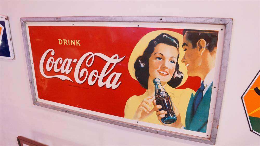 Gorgeous late 1940's large Coca-Cola tin sign with wood frame featuring period lady and gent. - Front 3/4 - 178880