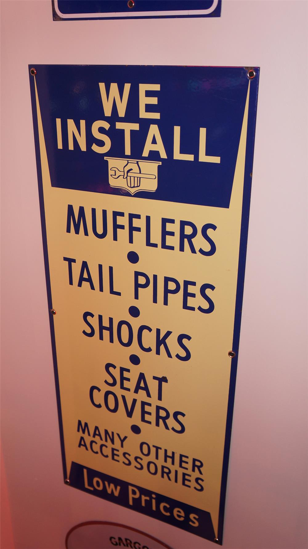 "N.O.S. 1940's We Install ""Mufflers-Tail Pipes-Shocks and more"" single-sided porcelain automotive garage sign. - Front 3/4 - 178909"