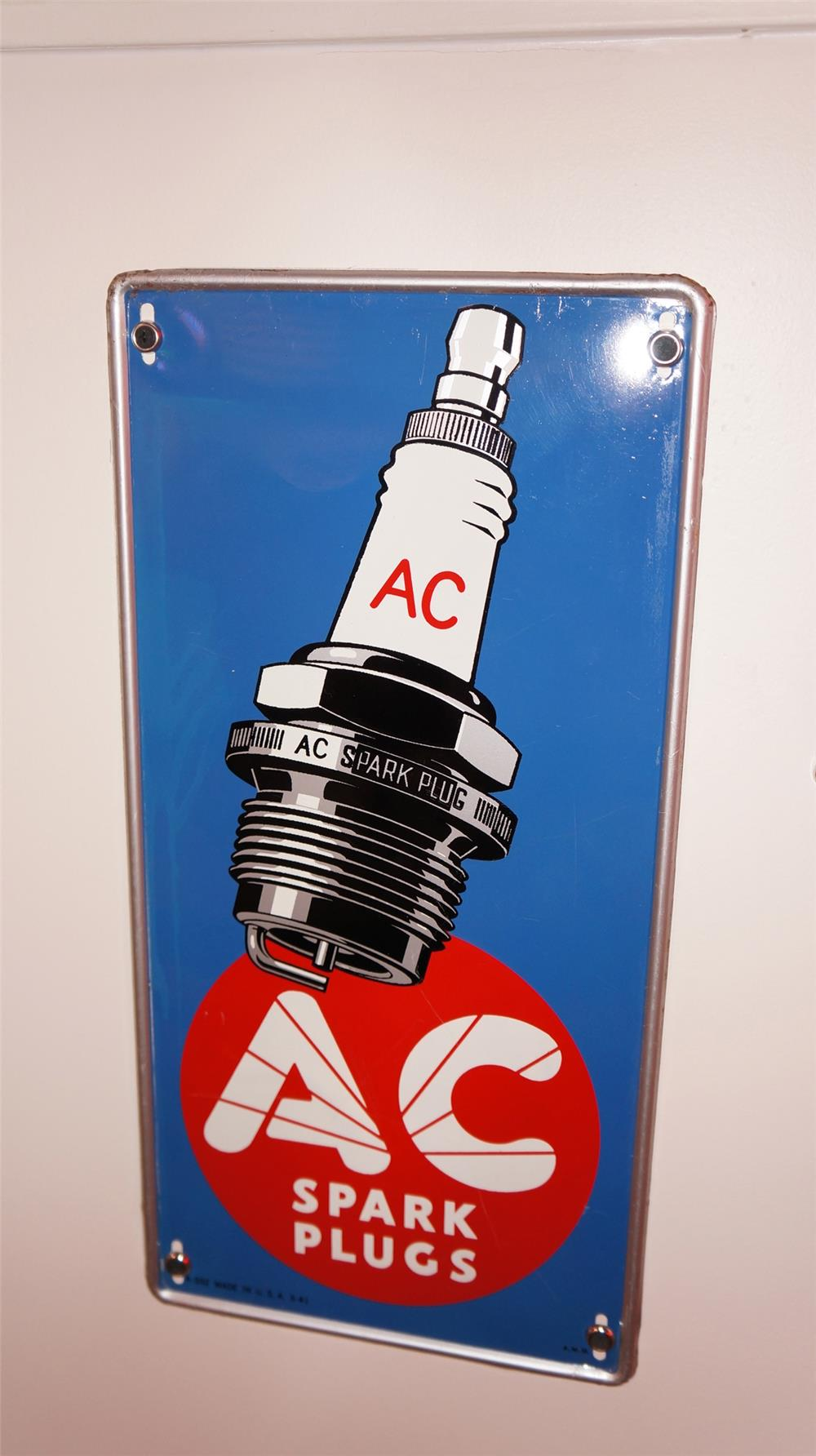 N.O.S. 1941 AC Spark Plugs self-framed vertical tin automotive garage sign with spark plug graphic. - Front 3/4 - 178930
