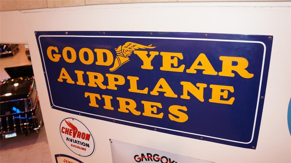 Magnificent 1940's Goodyear Airplane Tires single-sided porcelain airport hanger sign. - Front 3/4 - 178948