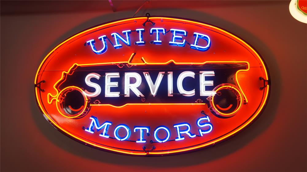 Fantastic large GM United Motor Service two piece neon porcelain automotive garage sign with articulated neon (simulates wheels turning). - Front 3/4 - 178983