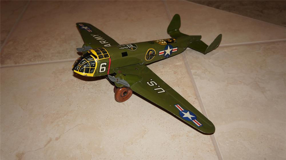 Sharp 1940's US Army tin litho wind-up airplane bomber by Marx Toys. - Front 3/4 - 179029