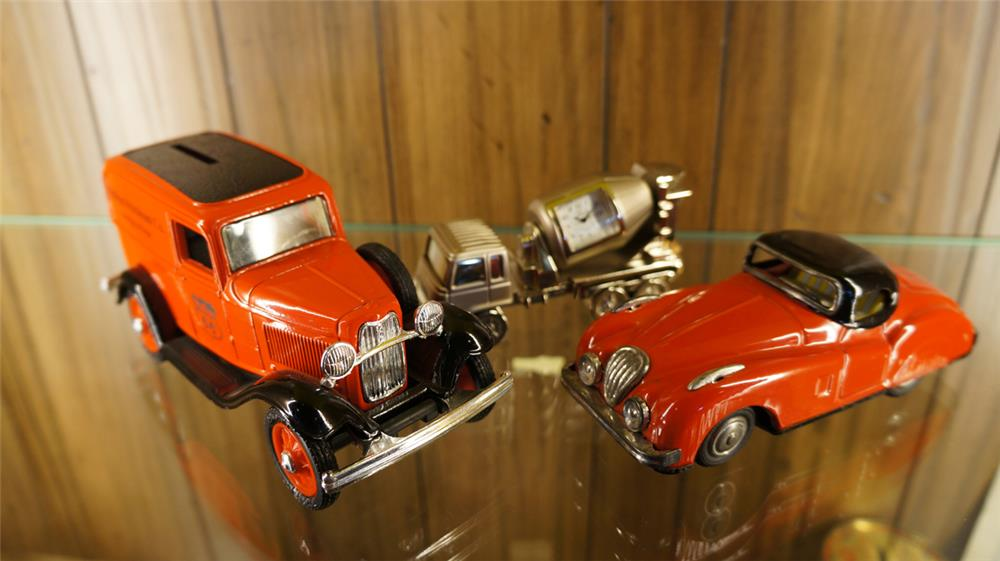 Lot of three toys including a 1950's tin litho Jaguar, Philips 66 Ford Ertl  die cast and cement truck Timex desk clock. - Front 3/4 - 179041