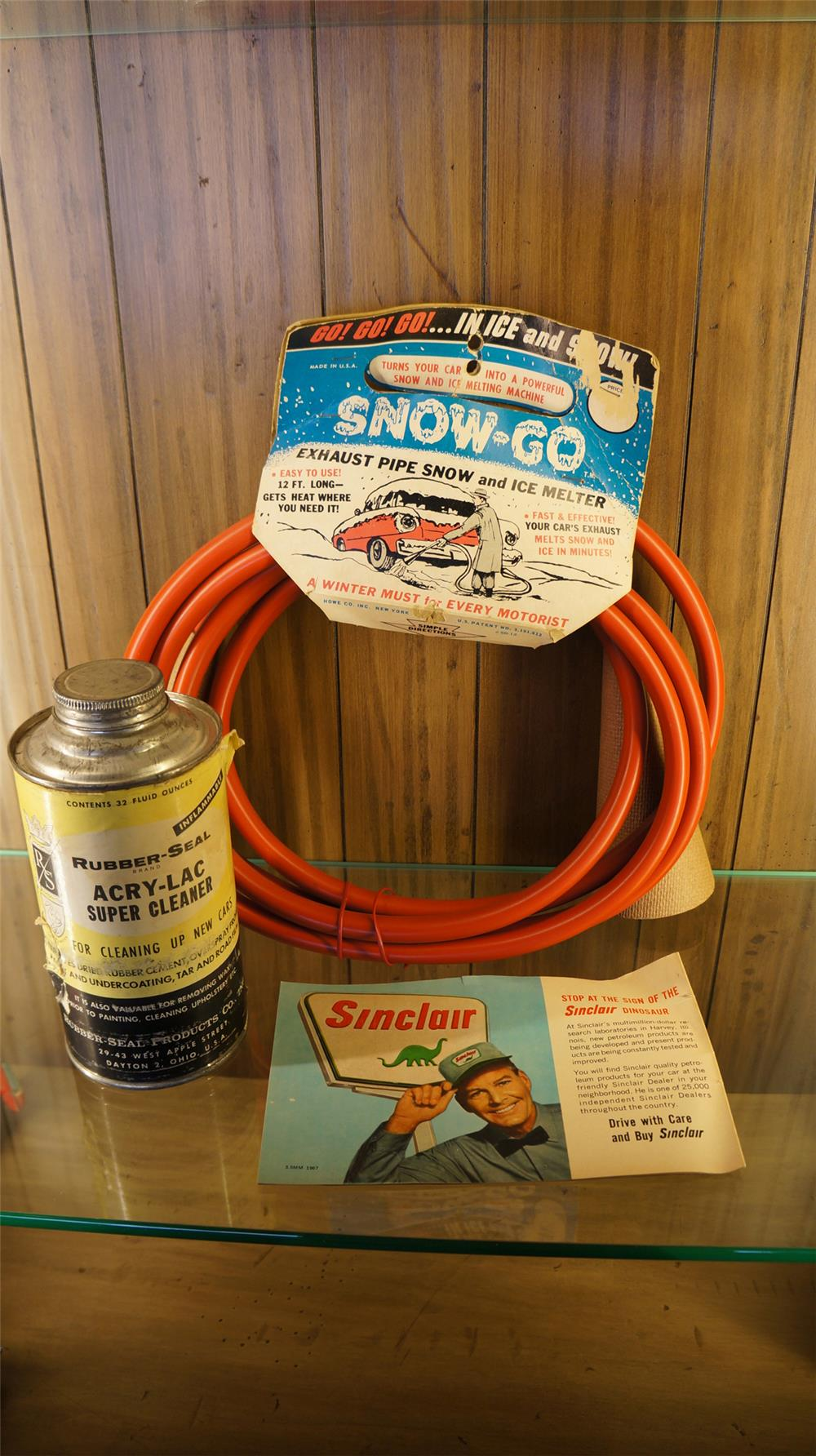 Lot of three 1950's service station items consisting of Sinclair Dinosaurs pamphlet, Snow-go exhaust remover and car cleaner kit. - Front 3/4 - 179073