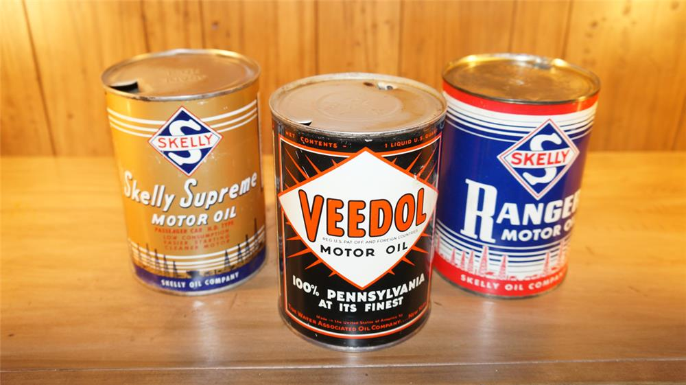 Lot of three vintage metal quart cans consisting of two Skelly and one Veedol. - Front 3/4 - 179088