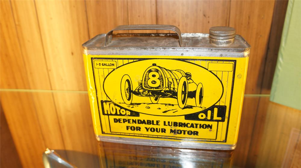 1920's-30's High grade motor oil half-gallon solder seamed tin with race car graphic. - Front 3/4 - 179113