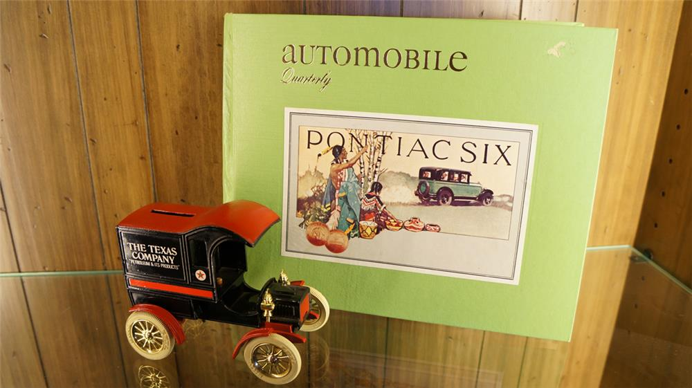 Lot consisting of a 1978 Automobile quarterly and Ertl 1904 Ford Texaco delivery wagon. - Front 3/4 - 179120