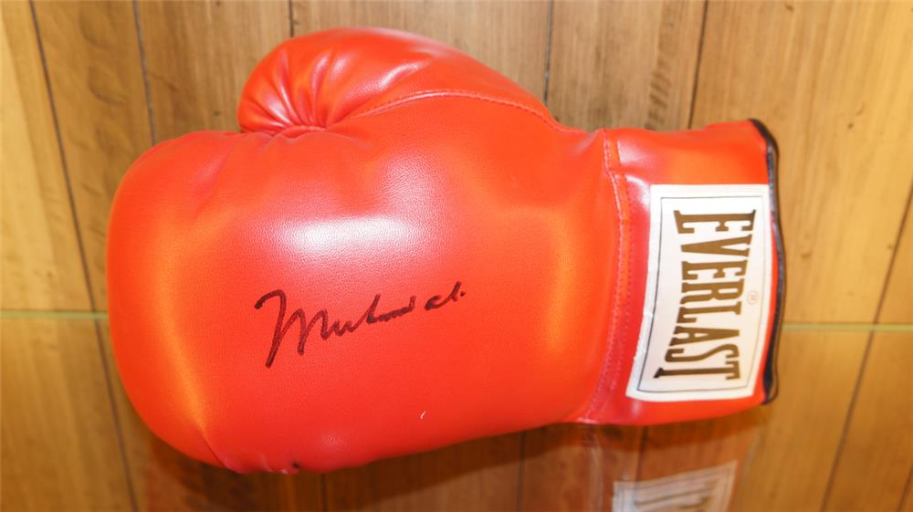 Muhammad Ali autographed Everlast boxing glove. Signed at Barrett-Jackson by Mr. Ali for Ron Pratte.  Condition: Never Used - Front 3/4 - 179199