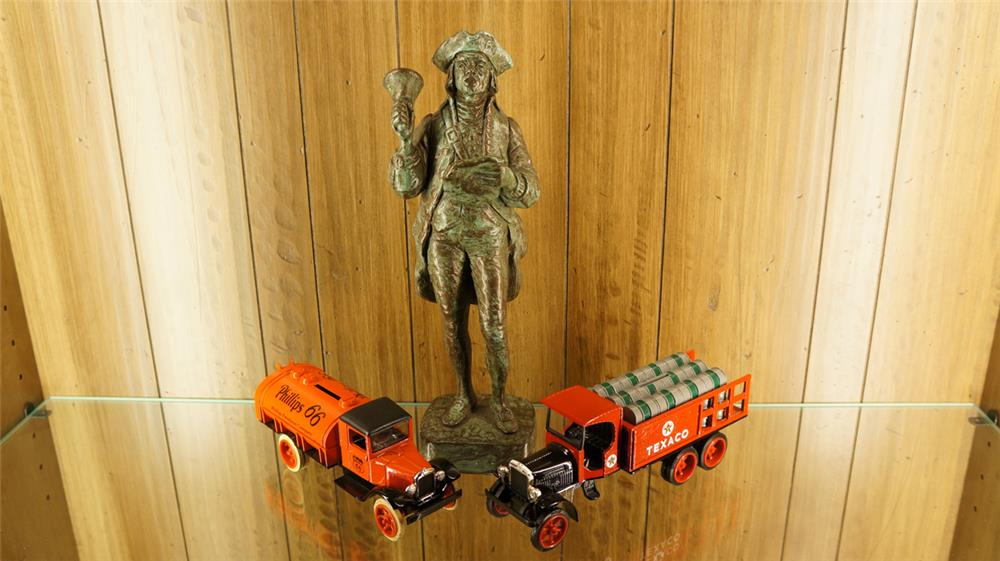 Lot of two Ertl Oil Delivery die-cast truck coin banks and a Town Crier statue. - Front 3/4 - 179205