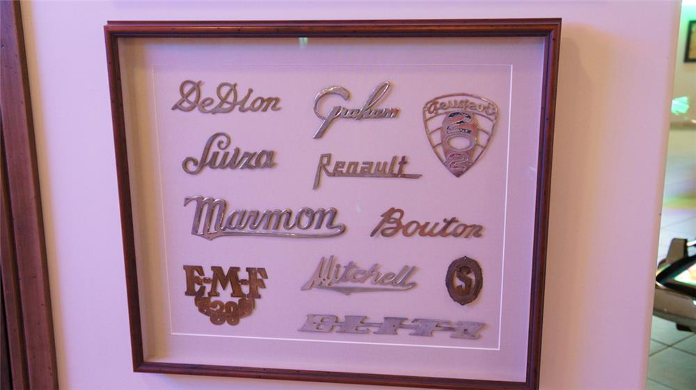 Impressive display of eleven brass car badges including Marmon, Mitchell, De Dion, Graham and others. - Front 3/4 - 179214