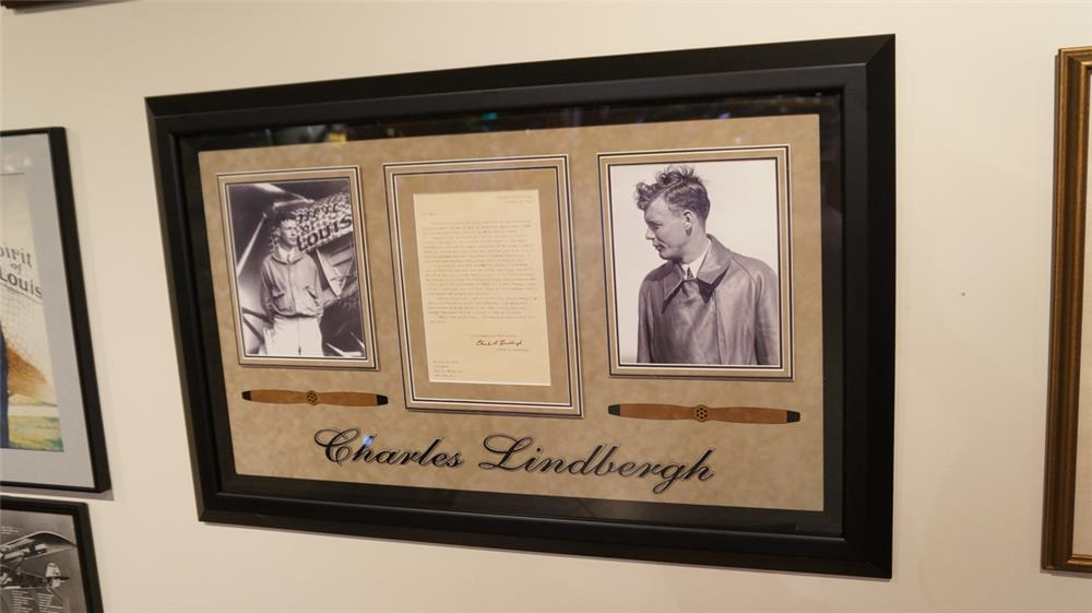 Phenomenal original Charles A Lindbergh correspondence letter with signature dated 1932 and several period photos.  Great display piece - Front 3/4 - 179230
