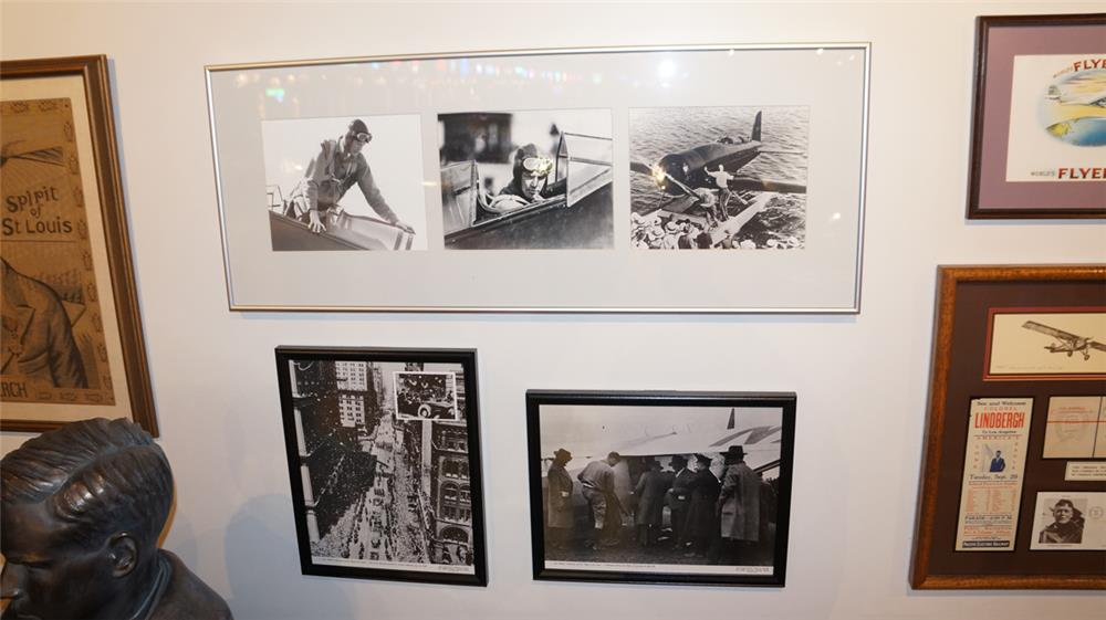 Lot of three Charles Lindberg framed photographs pertaining to ticker tape parade in NY, flight preparation for Paris and amphibious airplane. - Front 3/4 - 179233