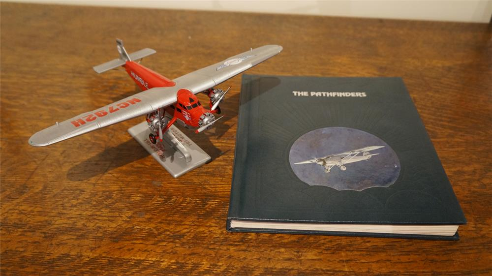 Commemorative Ertl Ford Tri-Motor die cast plane and the Pathfinders book. - Front 3/4 - 179258