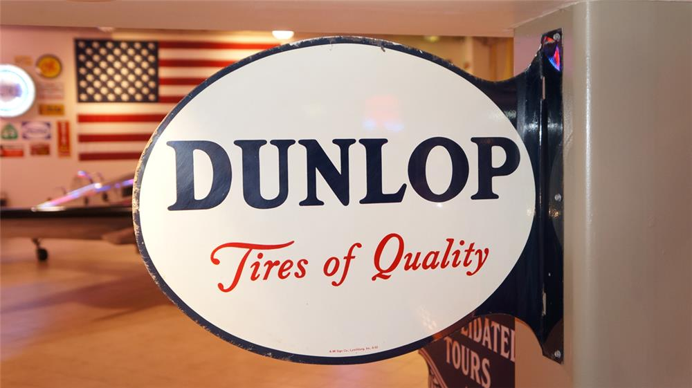 "1953 Dunlop tires ""Tires of Quality"" double-sided tin flange sign. - Front 3/4 - 179263"