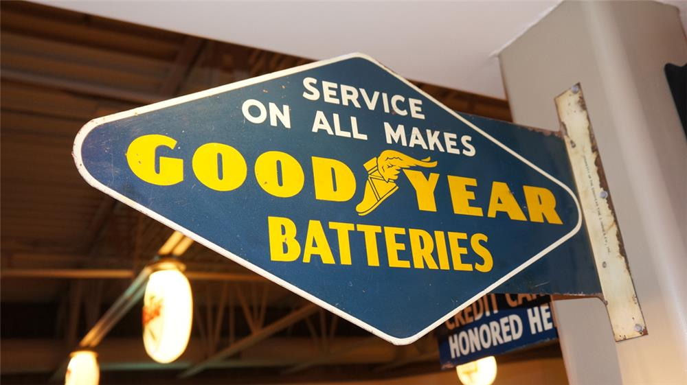 1940's Goodyear Batteries double sided tin flange sign with winged foot logo. - Front 3/4 - 179267