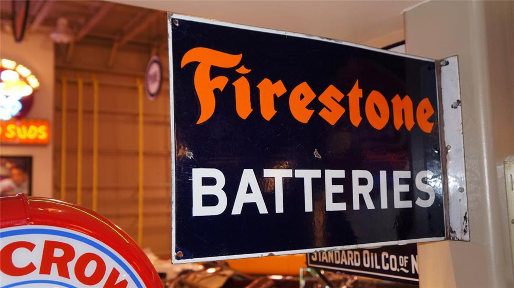 Outstanding 1930's Firestone Batteries double-sided porcelain service station flange sign. - Front 3/4 - 179273