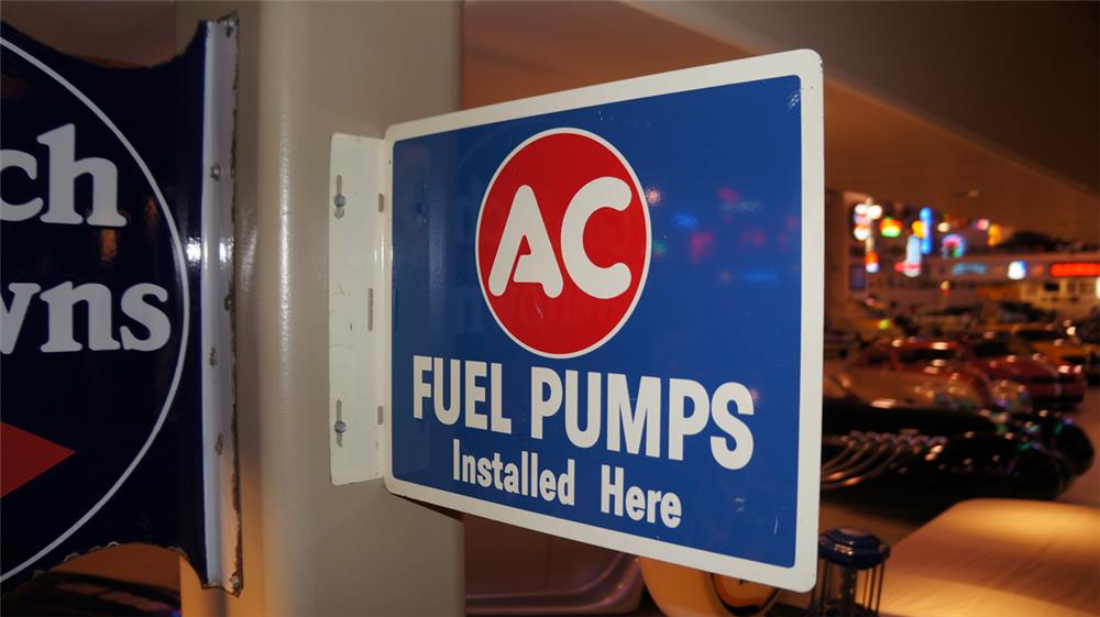 N.O.S. 1950's AC fuel pumps double-sided tin service station flange sign. - Front 3/4 - 179279