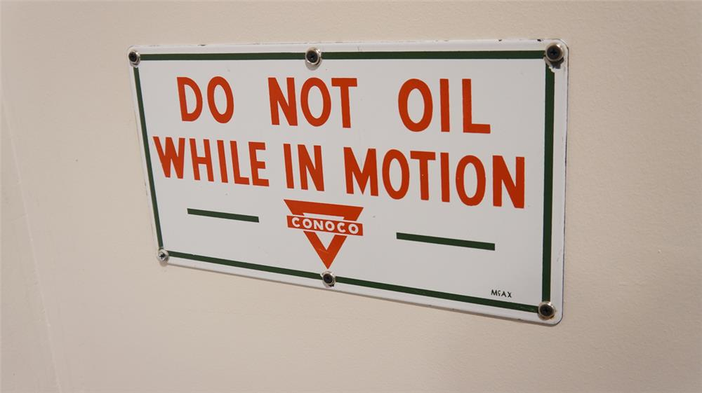 "1950's Conoco ""Do Not Oil While In Motion"" single-sided porcelain service department sign. - Front 3/4 - 179284"