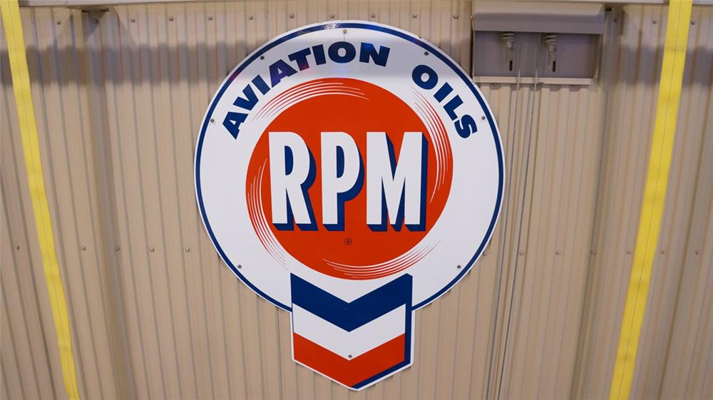 N.O.S. 1950's RPM Aviation Oils single-sided porcelain airport hanger sign. - Front 3/4 - 179296
