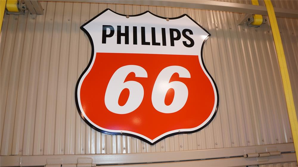 Large Phillips 66 double-sided porcelain shield-shaped service station sign. - Front 3/4 - 179297
