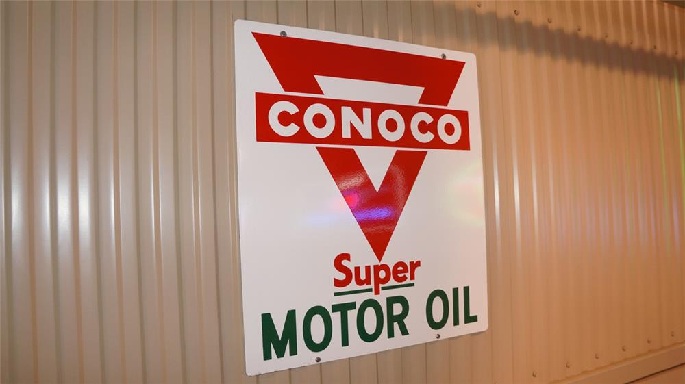 N.O.S 1950's Conoco Motor Oil double-sided porcelain service station sign. - Front 3/4 - 179301