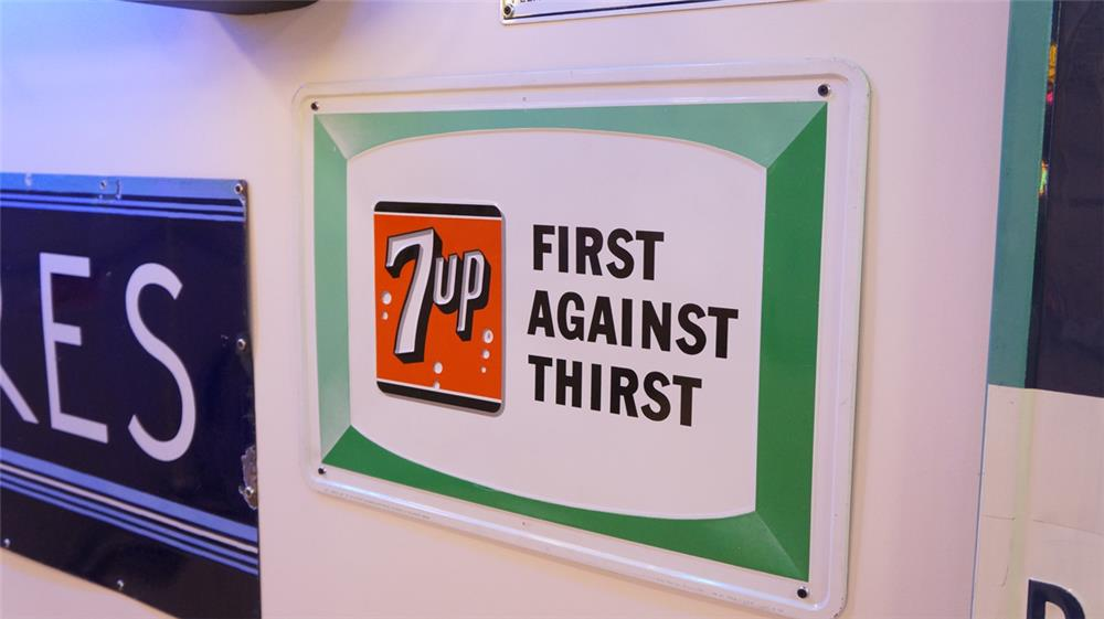 N.O.S. 1966 7-up First Against Thirst single-sided embossed tin soda sign. - Front 3/4 - 179337