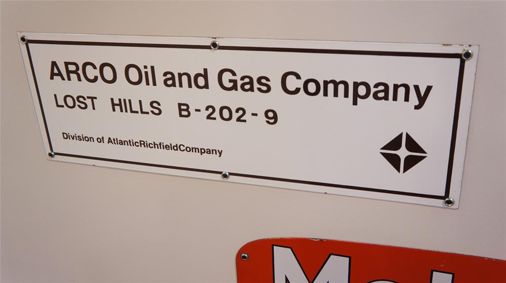 N.O.S. Arco Oil and Gas Company single-sided porcelain oil well sign. - Front 3/4 - 179346
