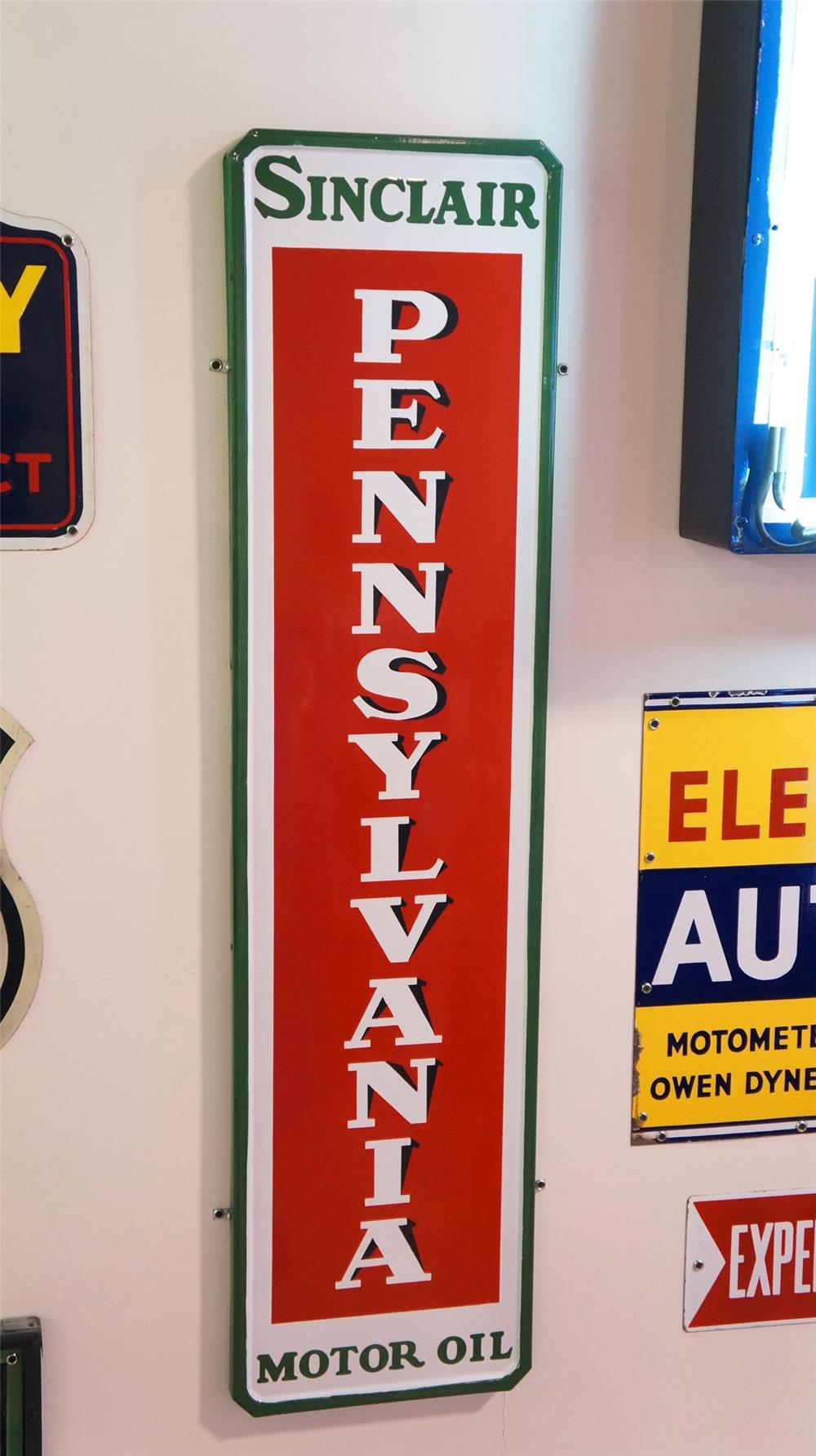 1930's N.O.S. Sinclair Pennsylvania Motor Oil self-framed porcelain vertical service station sign. - Front 3/4 - 179354