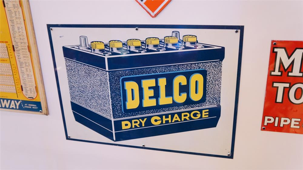 N.O.S. 1950's Delco Dry Charge Batteries double-sided tin sign with battery graphic. - Front 3/4 - 179392