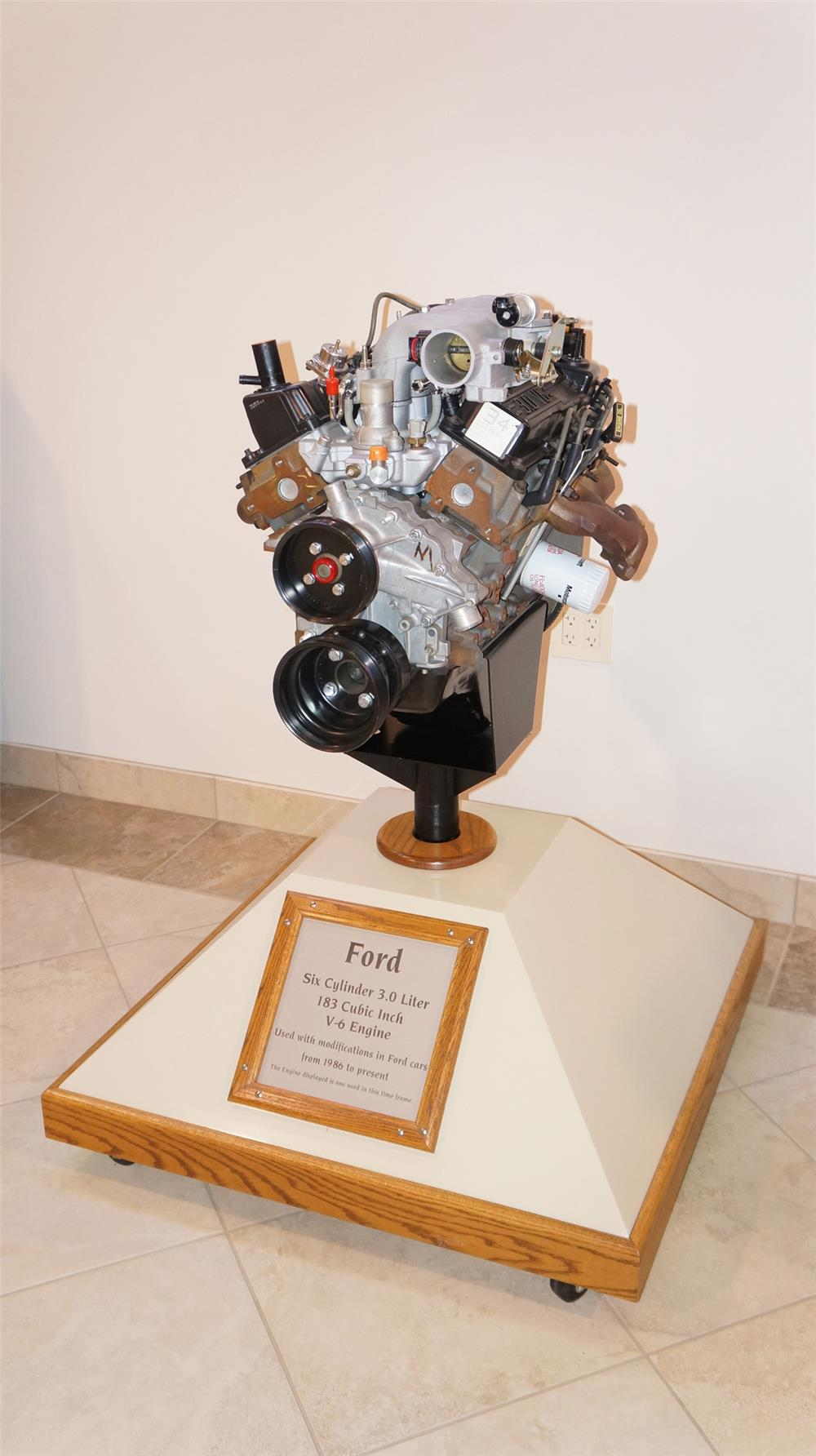 Ford Six Cylinder 3.o Liter 183 Cubic Inch V-6 engine on stand. - Front 3/4 - 179408