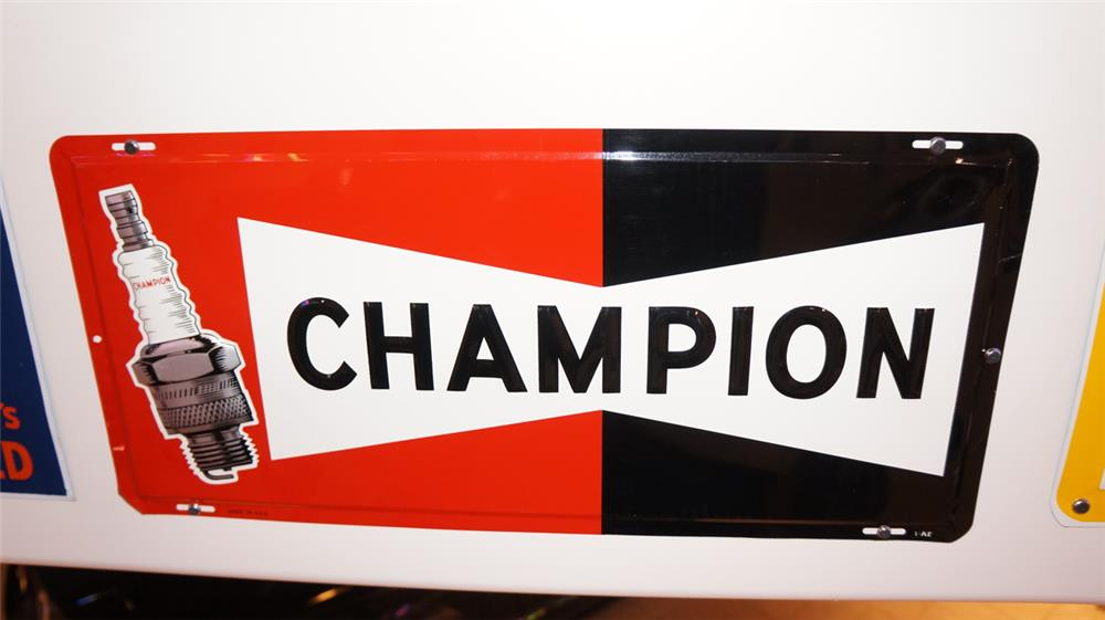 N.O.S. Champion Spark Plugs horizontal tin sign with plug graphic. - Front 3/4 - 179440