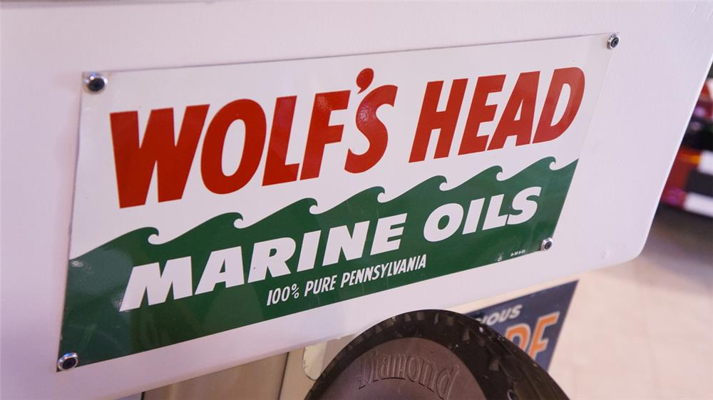 N.O.S. 1955 Wolf's Head Marine Oils single-sided tin service station sign. - Front 3/4 - 179447