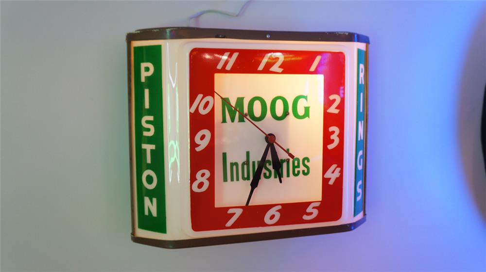 1950's Moog Industries Piston Rings light-up service station clock. - Front 3/4 - 179488