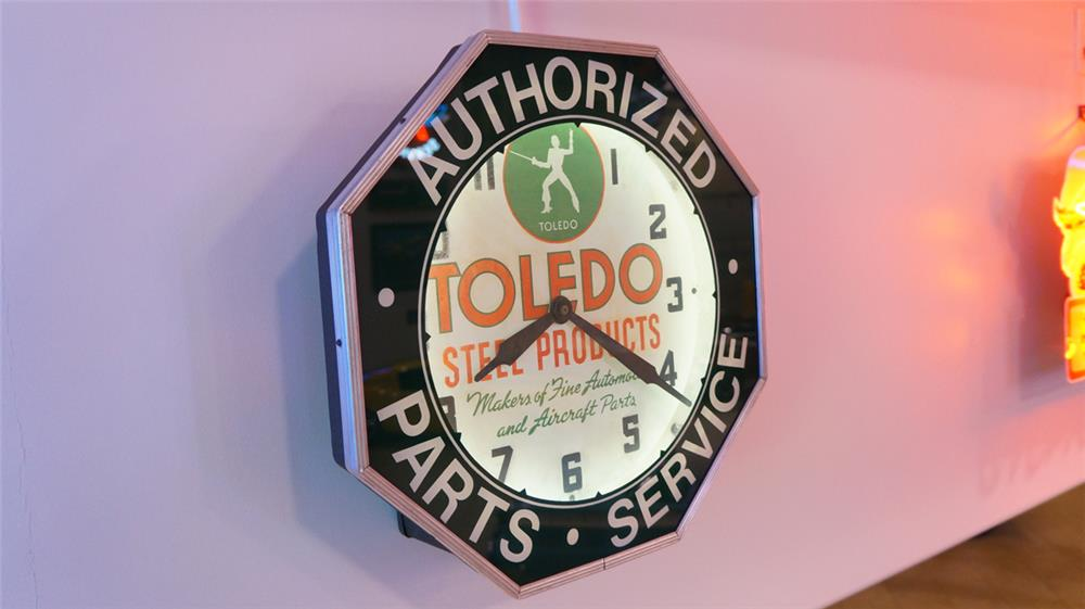 "1930's Toledo Steel Products ""Makers of Fine Automobiles and Aircraft Parts"" neon clock. - Front 3/4 - 179490"