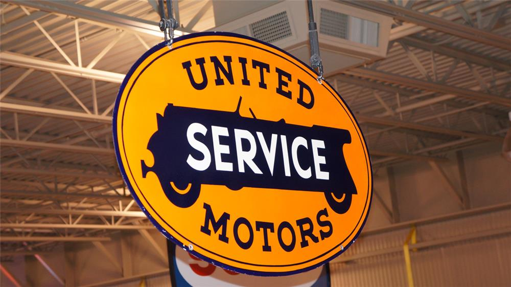 Stunning large 1930's United Motors Service double-sided porcelain dealership sign with touring car logo. - Front 3/4 - 179517